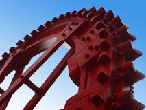 Wheel turbine. Big red bucket weehl turbine on blue background Stock Photo