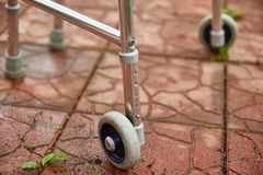 Wheel walker for adults. Close-up. Red road tile royalty free stock images