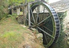 Wheel of a water mill. A wheel of a water mill Stock Image
