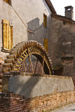 The wheel of the watermill Stock Photos