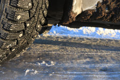 Wheel on  winter icy road Royalty Free Stock Photo