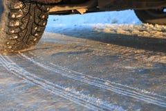 Wheel on winter icy road Stock Image