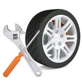 Wheel, wrench and a screwdriver Stock Photography