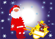 Wheelbarrow. Santa Claus with presents  in the snowflakes at christmas eve Royalty Free Stock Photo