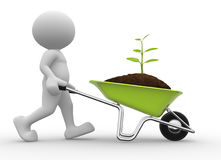 Wheelbarrow. 3d people - man, person with a wheelbarrow and a seedling Royalty Free Stock Photography