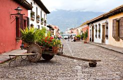 Wheelbarrow of Antigua. A Wheelbarrow of flowers nestled deep in the valley of Antigua, Guatemala Royalty Free Stock Photography