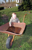 Wheelbarrow baby stock photos