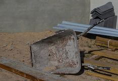Wheelbarrow on a building site. Wheelbarrow and building material on a building construction site image in landscape format Stock Images