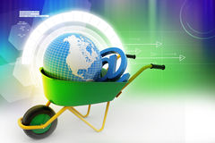 Wheelbarrow carrying earth and email sign Royalty Free Stock Photos