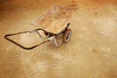 Wheelbarrow cart. On concrete floor Stock Photos