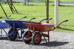 Wheelbarrow carts colorful material on the floor stock images