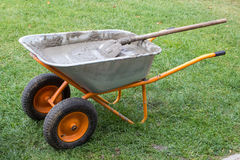 Wheelbarrow with cement Royalty Free Stock Image