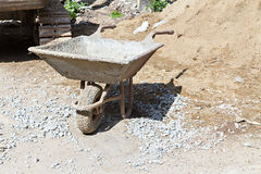 Wheelbarrow in construction site Stock Images