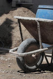 Wheelbarrow on construction site Stock Images