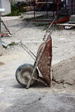 Wheelbarrow at construction site at siesta time Stock Images