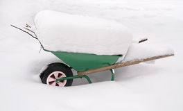 Wheelbarrow covered in snow Stock Image