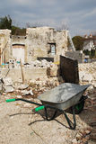 Wheelbarrow on Demolition Site Royalty Free Stock Image
