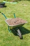 Wheelbarrow with dirt Royalty Free Stock Photography