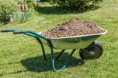 Wheelbarrow with dirt Stock Photo