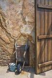 Wheelbarrow and door Royalty Free Stock Image
