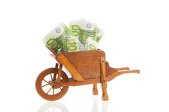 Wheelbarrow with Euro banknotes Stock Images