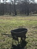 Wheelbarrow in a farm field Royalty Free Stock Image