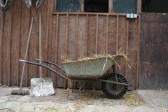 Wheelbarrow and farm tools at a farm Royalty Free Stock Images