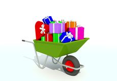 Wheelbarrow filled with gifts Royalty Free Stock Images