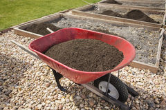 Wheelbarrow full of Compost Dirt Stock Images