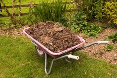 Wheelbarrow full of compost Stock Photography