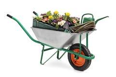 Wheelbarrow full of gardening equipment Royalty Free Stock Photography