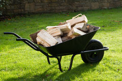 Wheelbarrow full of logs Royalty Free Stock Photo