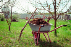Wheelbarrow full of manure, toned stock image