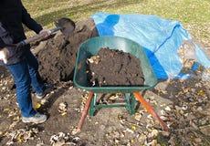 Wheelbarrow full of soil Stock Image
