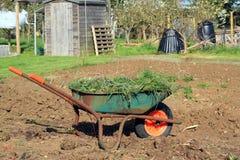 Wheelbarrow full of weeds. stock images