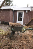 Wheelbarrow in garden Stock Photo