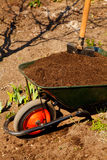 Wheelbarrow in a garden Stock Photos
