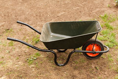 Wheelbarrow in a garden Stock Image