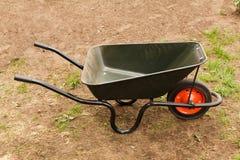 Wheelbarrow in a garden Stock Image