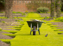 Wheelbarrow in a garden. A wheel barrow in the beautiful Kew's garden, London Royalty Free Stock Photography