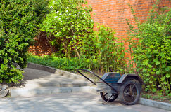 Wheelbarrow in Garden Stock Image