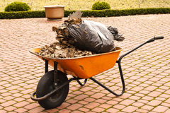 A wheelbarrow in the garden Royalty Free Stock Photos