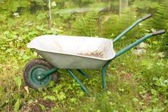 Wheelbarrow in a garden. On grass Stock Photo