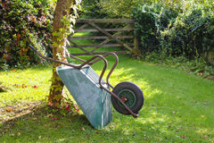 Wheelbarrow in garden Royalty Free Stock Photo