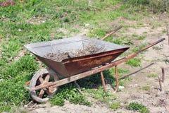 Wheelbarrow in the garden. Rural machinery royalty free stock image
