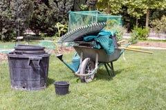 Wheelbarrow with gardening tools Stock Photo