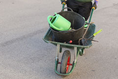 Wheelbarrow with gardening tools Royalty Free Stock Images