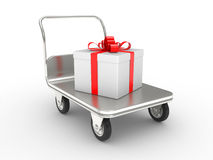 Wheelbarrow with gift box Stock Image