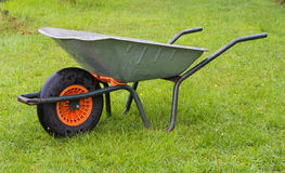 Wheelbarrow in the grass Royalty Free Stock Photography