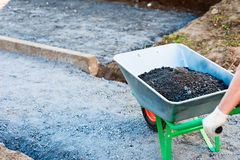 Wheelbarrow with gravel Stock Photo